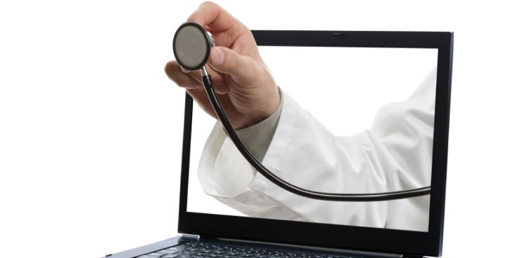 Laptop and doctor with stethoscope